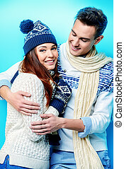 cheerful winter couple - Winter, christmas and love concept....