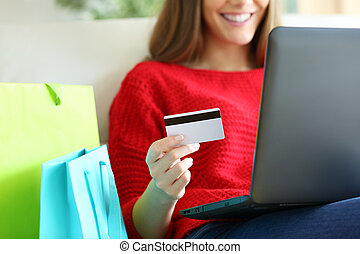 Girl buying on line with credit card - Close up of a girl...