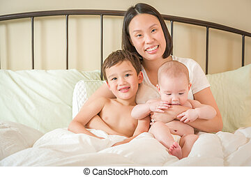 Mixed Race Chinese and Caucasian Baby Boys Laying In Bed...