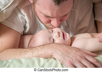 Mixed Race Chinese and Caucasian Baby Boy Laying In Bed with...