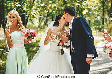 The brides kissing in the park