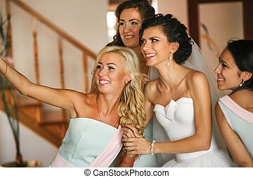 The happinest bride with bridesmaids
