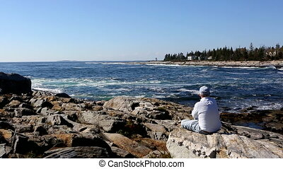 Retired Senior Adult Watching Surf Maine Coastline