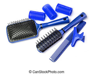 Curlers with hairbrush on white background