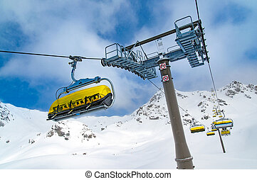 Ski lift on slope in Austrian resort Obertauern, winter time