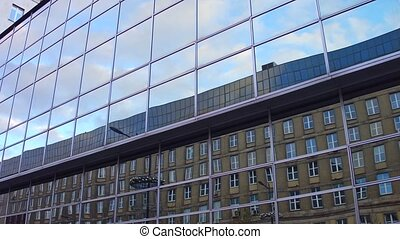Modern mirror glass office building reflections. Old and...