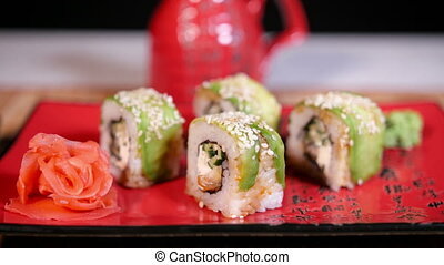 Japanese Green Sushi On Plate With Chopsticks On Bamboo...