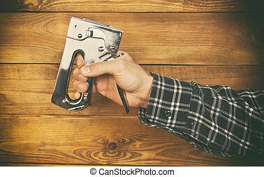 Stapler - One stapler in man's hand