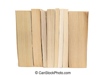 Stack of old paperback books isolated on white background