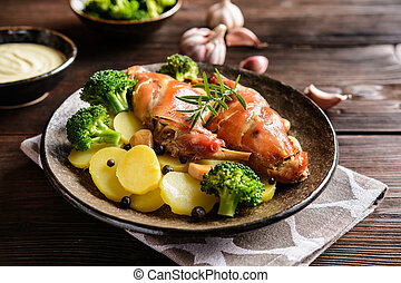 Roasted rabbit meat with potato and broccoli - Roasted...