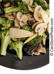 Chinese food. Broccoli with chinese mushrooms