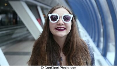 Girl with sunglasses playing and flirting