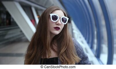 Girl with sunglasses playing and flirting.