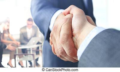 Closeup of a business handshake - closeup of handshake of...