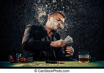 rich gambler - Rich gambler man with the cards and chips in...
