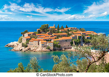 Sveti Stefan island in Budva in a beautiful summer day,...