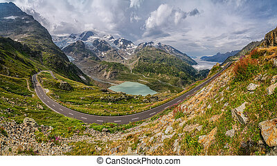 Mountain pass road in gorgeous alpine scenery in summer -...