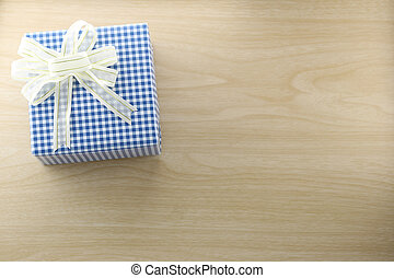 Gift box is placed on wooden floor. - Gift box is placed on...