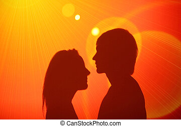 loving couple disco - shadows of a loving couple at wall on...