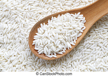 Organic white rice in wooden spoon, glutinous rice or sticky...