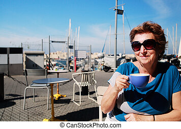 Outdoor portrait of 70 years old woman