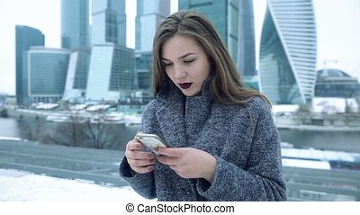 Girl enjoys a smartphone high-rise.