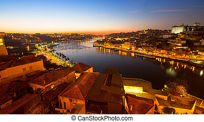 Night view of the Douro river in Porto, Portugal.