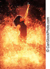 Woman on Fire - Beautiful woman standing in the midst of a...