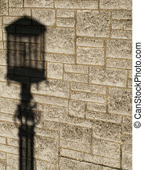 Street lamp - Shadow of vintage style street lamp on stone...