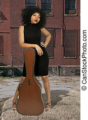 Woman with Guitar - Beautiful young woman with a acoustic...