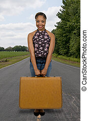 Vacation - Beautiful young woman going on vacation with a...