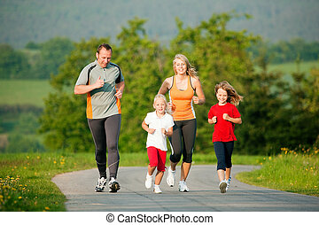 Family Jogging - Family  jogging with two little daughters