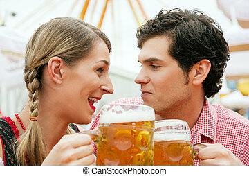 Couple in a beer tent - Couple in traditional German costume...