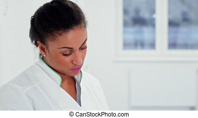 Female doctor poses at hospital - African american female...