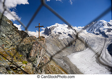 Wooden cross and glacier take through the net at Gornergrat...