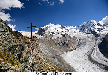 The wooden cross and glacier at Gornergrat station in...