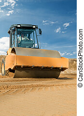 Earth vibration compactor at work - soil vibration roller...