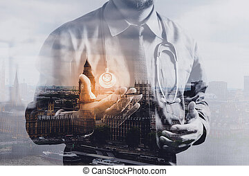 Double exposure of smart medical doctor holding digital...