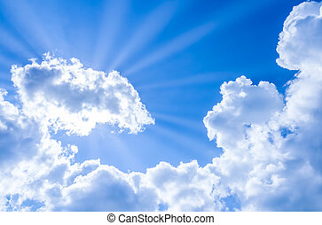 sun rays breaking through the clouds on blue sky - sun rays...
