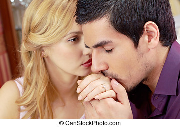 Romantic moment in restaurant - Man kissing woman s hand in...