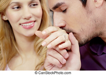 Kissing hand of wife - Young man kissing girlfriend s hand...
