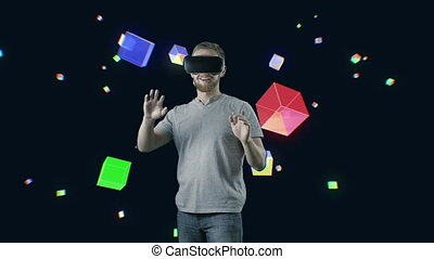 Man with VR gear glasses within interactive space touch...