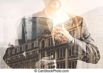 Double exposure of success businessman holding neck tie with...