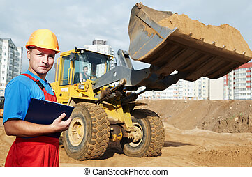 smiling Builder inspector at construction area - One happy...