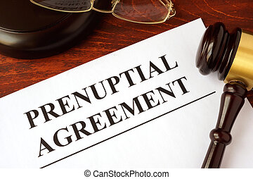 Papers with title prenuptial agreement on a table.