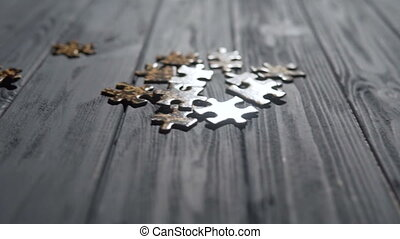 Falling Puzzle Parts on Blue Table - a indoor shot of...