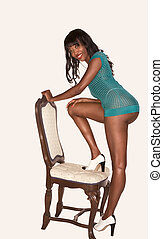 Leggy black girl in sensual pose wearing green