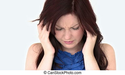Beautiful woman having a headache against a white background...