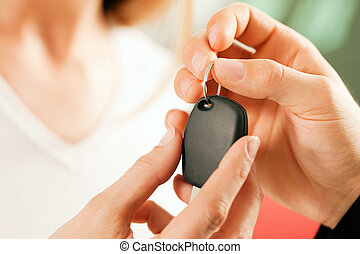 Woman buying car - key being given - Woman at a car...