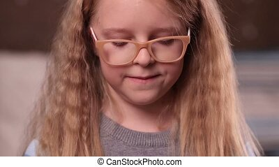 Cute little girl in glasses smiling - Half length of...